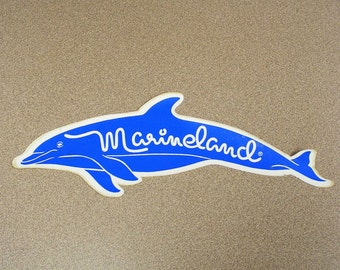 Marineland Florida vintage dolphin shaped bumper sticker royal blue cyan car decal fish
