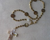 Lutheran prayer beads with small metal crosses and shell beads