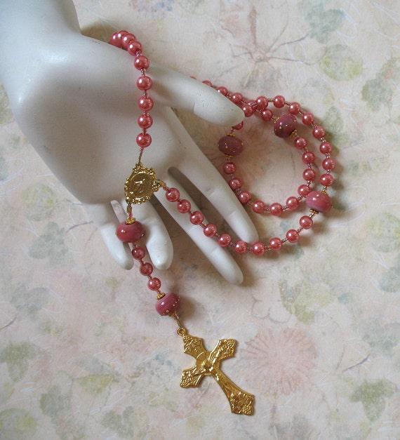 Catholic rosary with dark pink glass pearls