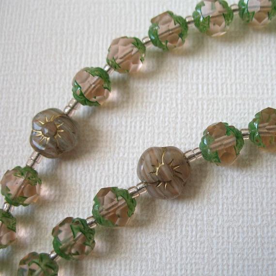 Light pink Catholic rosary - Might be rosebuds