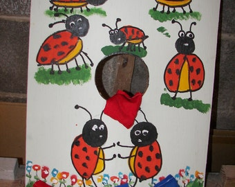 Lady bugs    bean  toss    game   with 4   bean bags