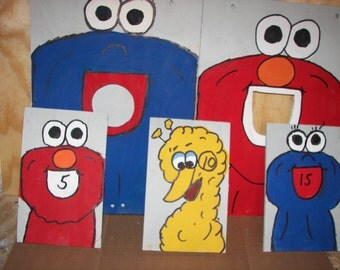 ELMO & COOKIE MONSTER   corn hole   toss  games 3  times the fun