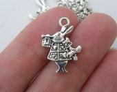 8 White Rabbit charms antique silver tone A246