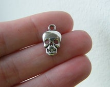 BULK 50 Skull charms antique silver tone HC96