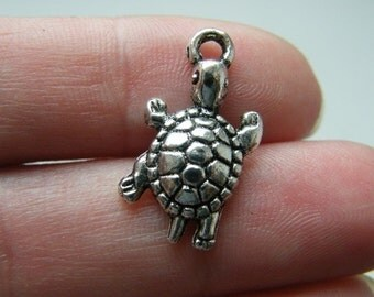 8 Tortoise charms  antique silver tone FF131