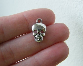 BULK 50 Skull charms antique silver tone HC96