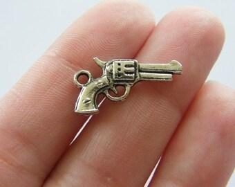 10 gun charms antique silver tone G1