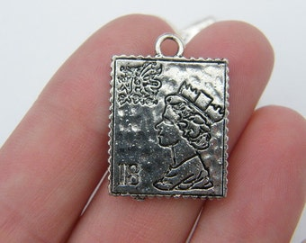 4 Stamp charms antique silver tone PT54