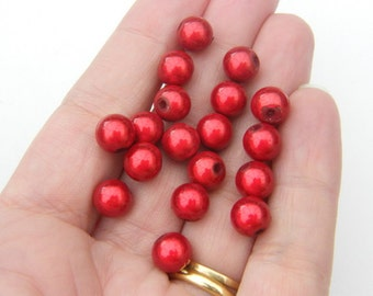 20 Christmas red miracle beads