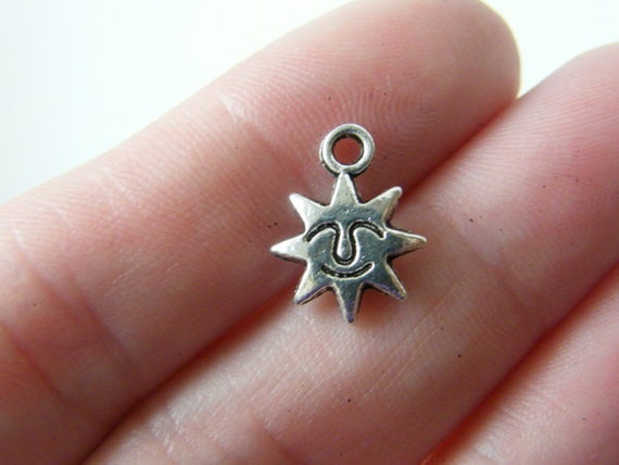 12 Star charms ( double sided ) 14 x 10mm tibetan silver