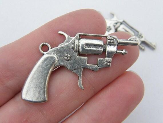 3 Gun pendants ( double sided ) 39 x 26mm tibetan silver G7