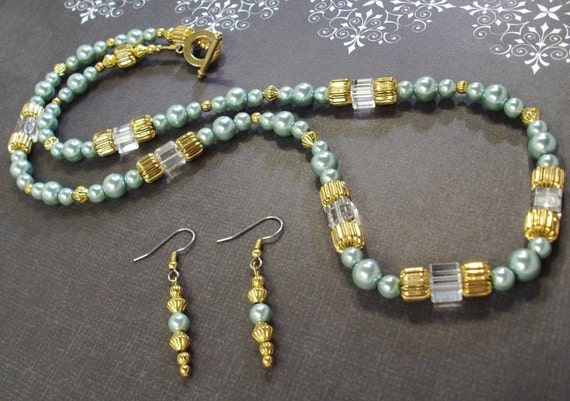 Tantalizing Teal Pearl with Gold and Crystals Necklace and Earring Set