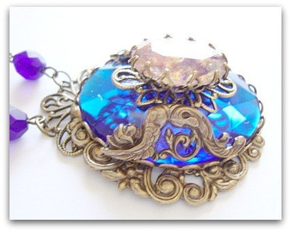 Antique Brass, Faceted Blue Cabochon, and Antique brass filigree Necklace