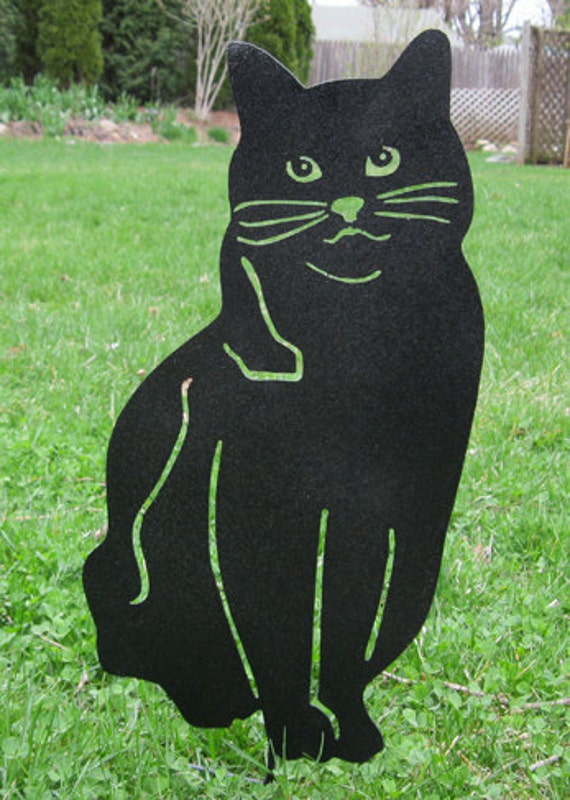 Unavailable listing on etsy for Cat yard art