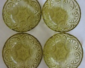 Set of four (4) mid 20th century, amber, pressed glass sauce or compote dishes