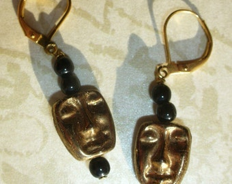 Mystery faces. Bronze human head earrings. With gold-filled lever back ear wires.