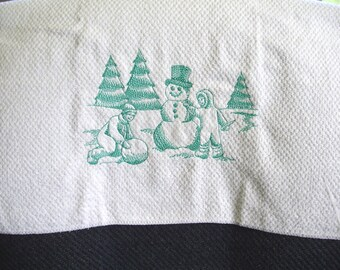 Embroidered towel - one color design - building a snowman
