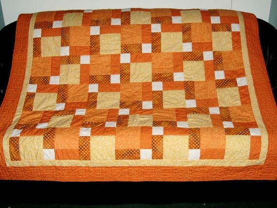 Patchwork quilt - disappearing 9 patch - orange and yellows
