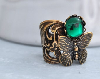 BUTTERFLY IN MOTION, Neo Victorian style vintage repurposed ring with butterfly charm and emerald Swarovski glass cab