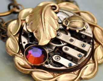 steampunk necklace ENCHANTED FOREST golden brass vintage watch movement and vintage leaf charm and Swarovski rhinestone