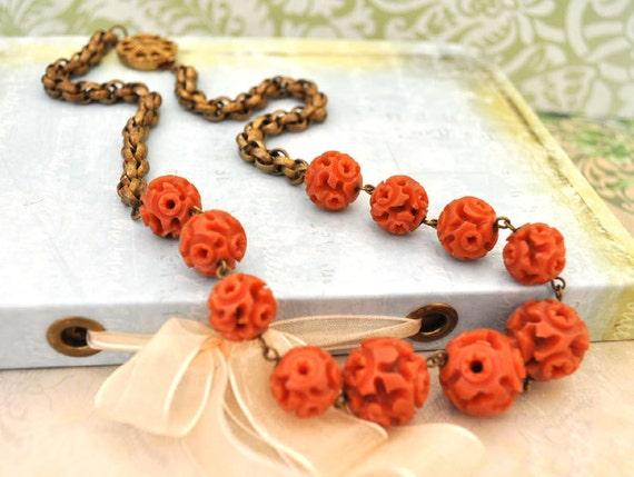 VINTAGE FIND vintage 1920s hand carved Celluloid red coral color necklace in antiqued brass