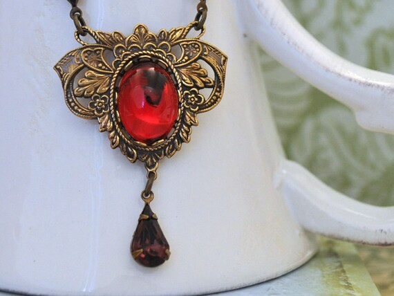 VAMPIRE KISSES, Victorian inspired antique brass jeweled necklace with vintage ruby red Swarovski glass cab