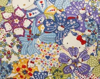 Liberty tana lawn - Mauvey Hello Kitty printed in Japan - Navy blue mix