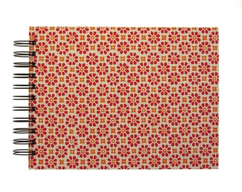 red orange Photo Album, spiral bound album