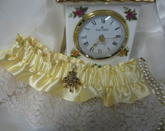 Victorian Yellow and Ivory Garter with Blue Jewel