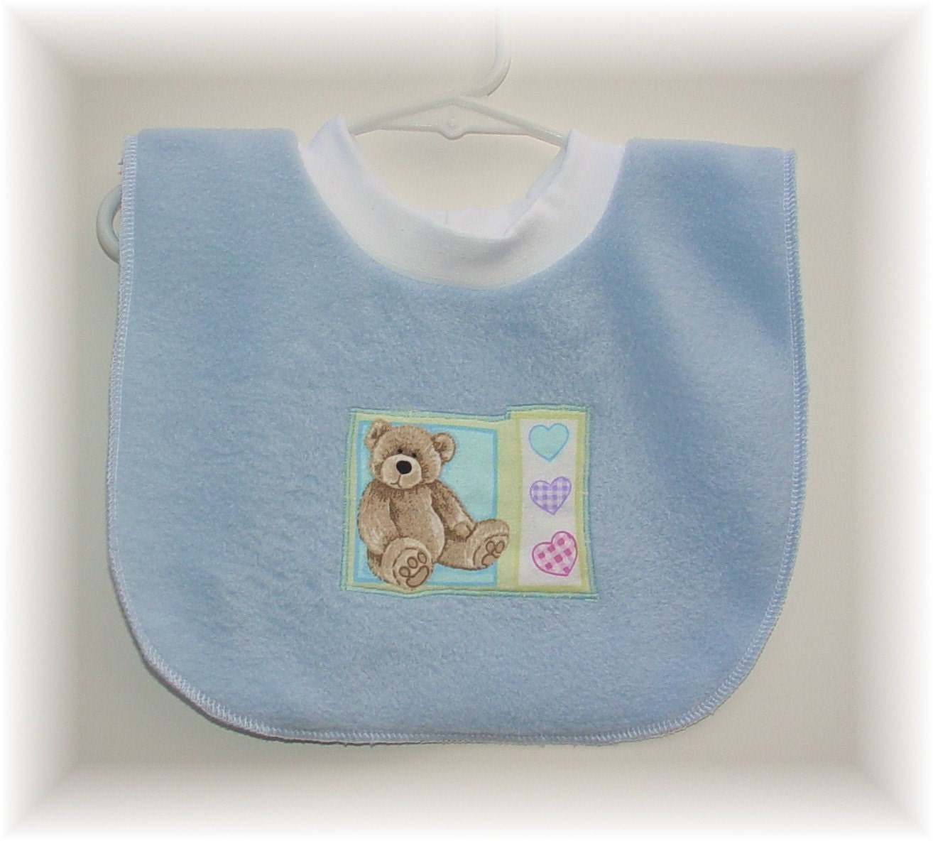 baby bib pullover blue fleece bib with teddy bear and heart. Black Bedroom Furniture Sets. Home Design Ideas