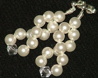 Cream Swarovski crystal pearl and clear crystal dangly earrings