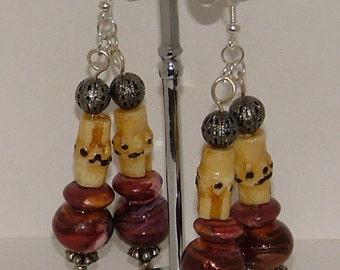 Brown cream dangly earrings with wood and metal beads