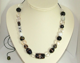 Black and white adjustable length cord necklace with Indian glass beads