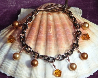 Antiqued Copper Charm Bracelet With Leaf Clasp And Amber Swaroski Crystals