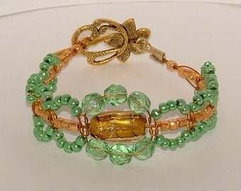 Green and gold beaded macrame bracelet