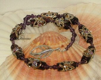Purple multi-coloured and silver necklace with foiled glass beads