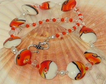 Orange and white necklace with lampwork and crystal beads