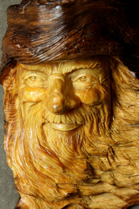 Jasper the Elf Wizard carved in a pine knot