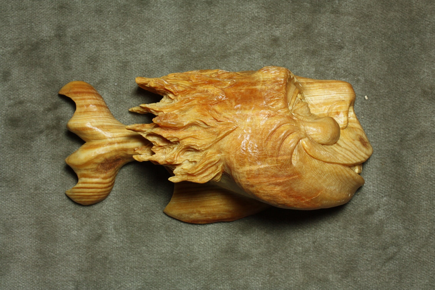 Funny wood carving of a fantasy fish carved by gary wiz burns for Fish wood carving