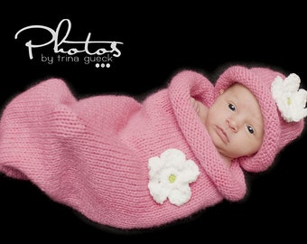 Knitted Baby Cocoon with hat (bright pink/white).  Fits 0 to 4 months