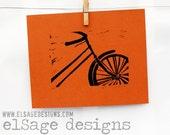 Vintage Bike black ink on orange paper hand printed limited edition