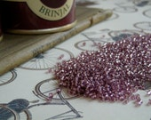 Japanease seed beads No. 40, mauve, silver lined, 10g