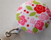 ID Badge Reel (Retractable), pink and green floral design, from fabric covered buttons, handmade by JEJEWELED