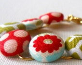 Fabric Covered Button Bracelet (red, green, blue, white) from fabric covered buttons, handmade by JEJEWELED