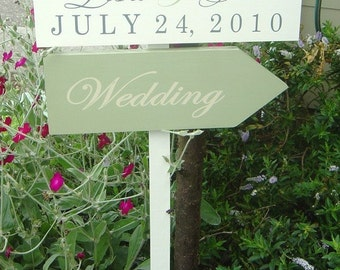 Personalized Wood Directional Signs with Arrow. This sign was featured in the May/June 2011 Issue of Destination Weddings and Honeymoons.