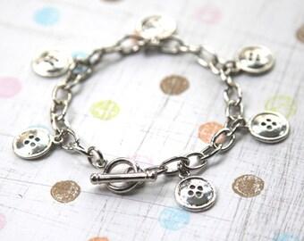 Button up - Silver Charm Bracelet