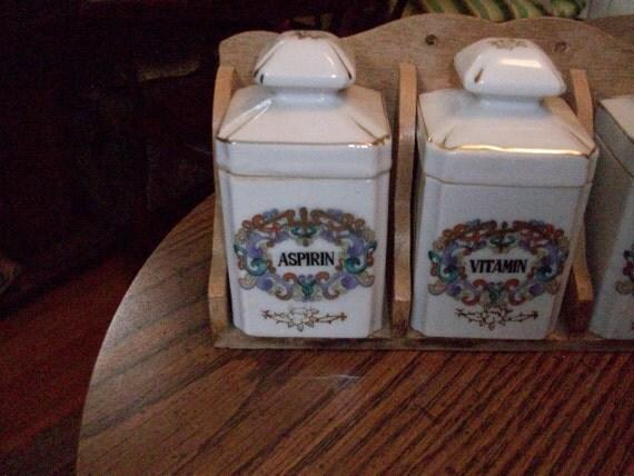 Bathroom Jars on rack Asprin Gauze and Vitamins