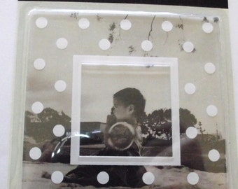 Sheer white polka dotted frame New in package