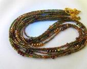 Seamstress for the Band-Necklace Sparkling golden olive/wine necklace multistrand golden