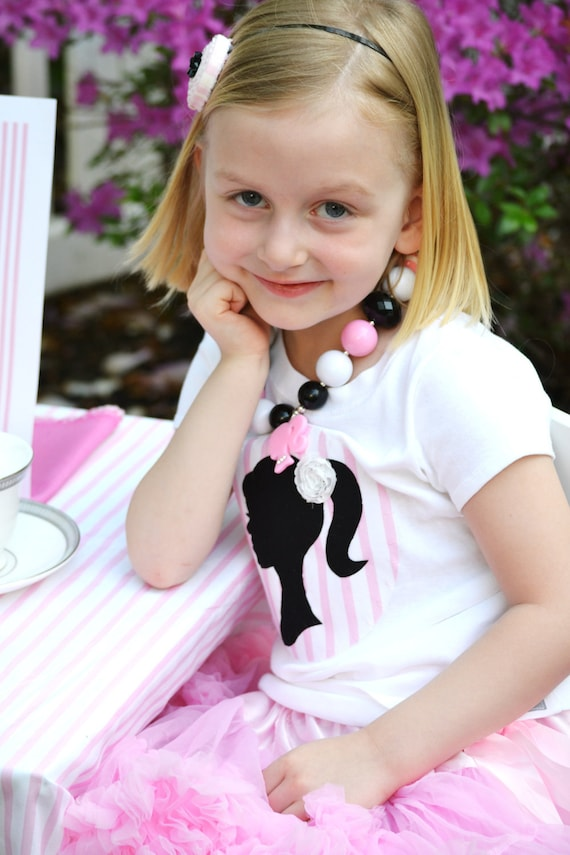 Girls Doll Silhouette Birthday Party Shirt in Pink and Black with White Rosette Flower Accent